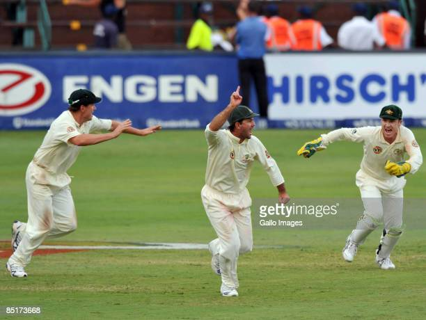 Ricky Ponting of Australia and team mates celebrate at the final wicket and Test victory during day five of the First Test between South Africa and...