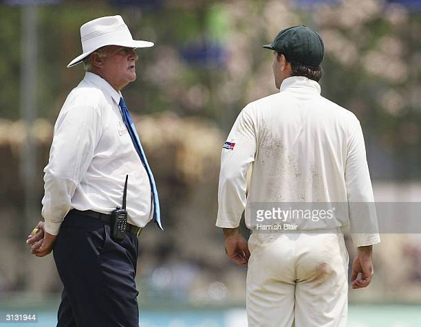 Ricky Ponting of Australia and umpire David Orchard discuss an incident that lead to the third umpire being called to investigate an appeal for hit...