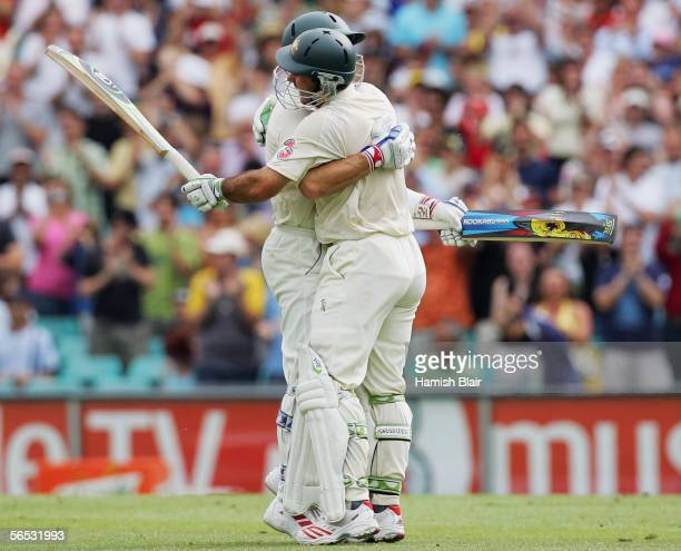 Ricky Ponting of Australia celebrates the winning runs with team mate Brad Hodge during day five of the Third Test between Australia and South Africa...