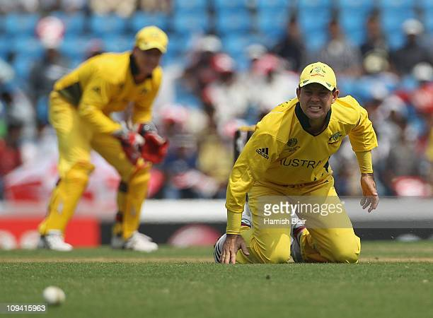 Ricky Ponting of Australia grimaces after being struck on his injured finger by a drive from Nathan McCullum of New Zealand during the 2011 ICC World...