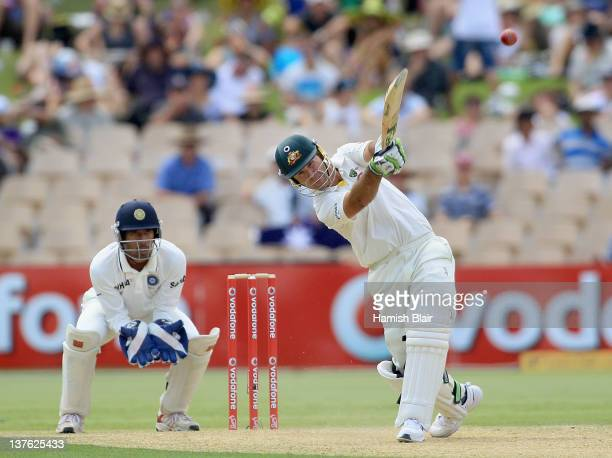 Ricky Ponting of Australia hits four to long off with Wriddhiman Saha of India looking on during day one of the Fourth Test Match between Australia...