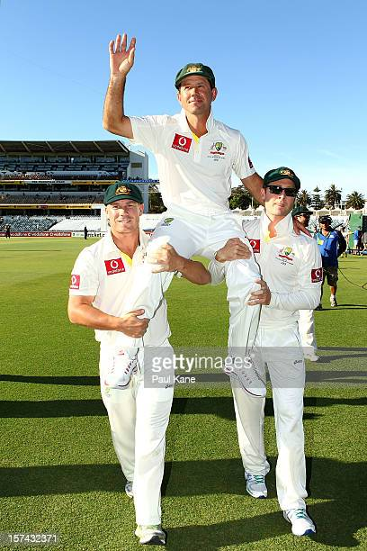 Ricky Ponting of Australia is chaired from the ground by David Warner and Michael Clarke after retiring from International cricket during day four of...