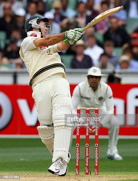 Ricky Ponting of Australia is hit by a short ball from Umesh Yadav of India during day one of the First Test match between Australia and India at...