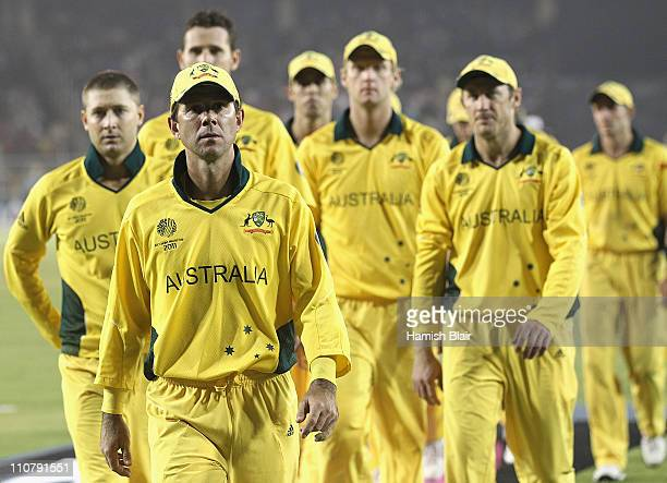 Ricky Ponting of Australia leads his team from the field after their loss during the 2011 ICC World Cup Quarter Final match between Australia and...
