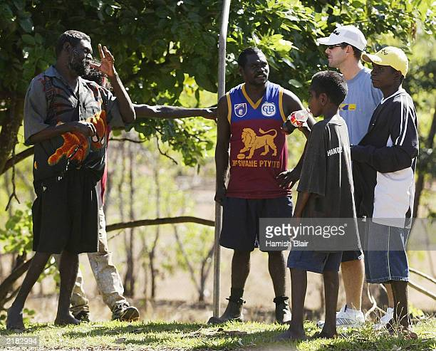 Ricky Ponting of Australia meets some locals on July 22 2003 during a team visit to an Aboriginal settlement on Melville Island off the coast of...