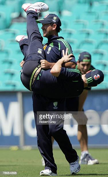 Ricky Ponting of Australia picks Michael Clarke up after celebrating a try in a warm up touch football game during an Australian nets session at the...