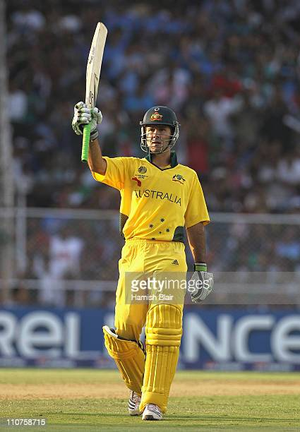 Ricky Ponting of Australia reaches his century during the 2011 ICC World Cup Quarter Final match between Australia and India at Sardar Patel Stadium...