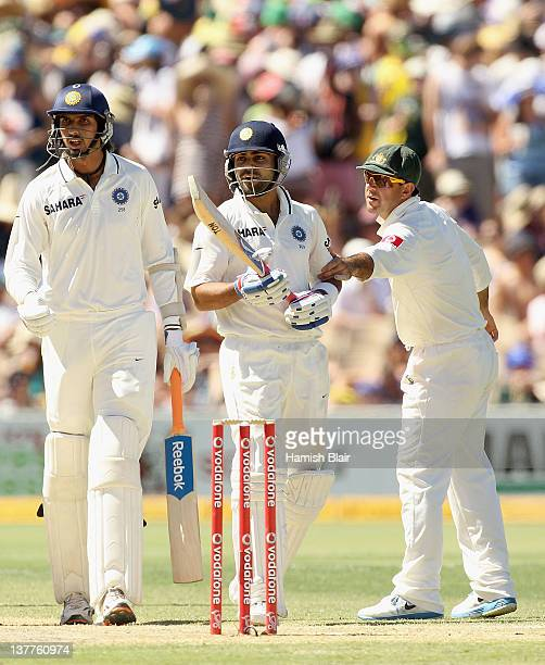 Ricky Ponting of Australia restrains Virat Kohli of India as he argues with Australian players during day three of the Fourth Test Match between...