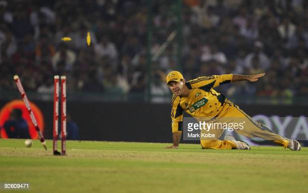 Ricky Ponting of Australia runs out Yuvraj Singh of India with a direct hit during the fourth One Day International match between India and Australia...