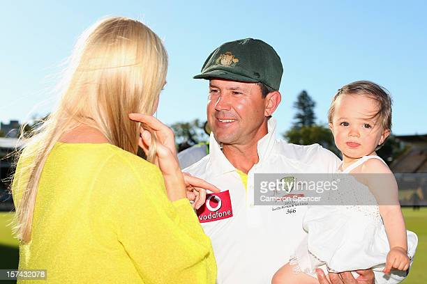 Ricky Ponting of Australia talks to his wife Rianna with daughter Matisse in hand following playing his last test match for Australia during day four...