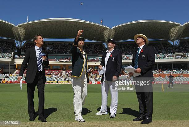 Ricky Ponting of Australia tosses the coin with Andrew Strauss of England looking on ahead of day one of the Second Ashes Test match between...