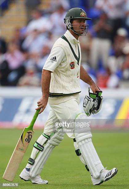 Ricky Ponting of Australia walks back after being dismissed by Monty Panesar of England during day three of the npower 1st Ashes Test Match between...
