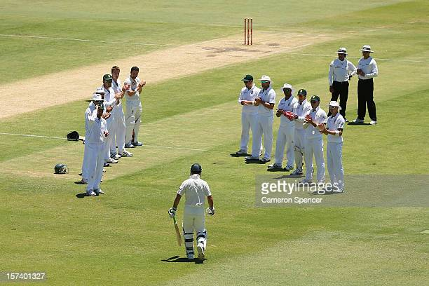 Ricky Ponting of Australia walks through a South African player guard of honour as he heads onto the field to bat during day four of the Third Test...