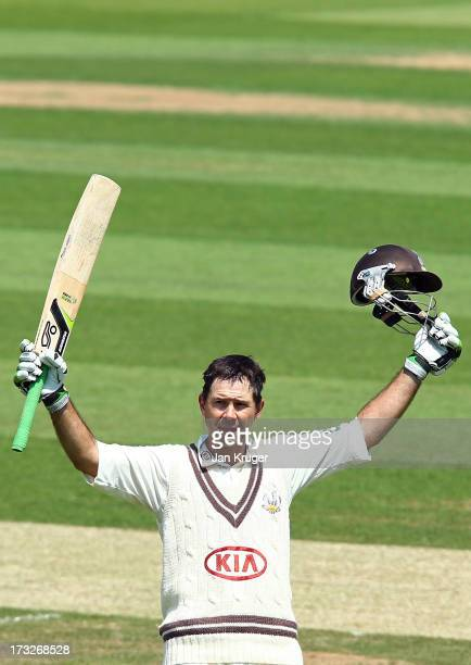 Ricky Ponting of Surrey celebrates and acknowledges the crowd as he reaches his century during the LV County Championship match between Surrey and...