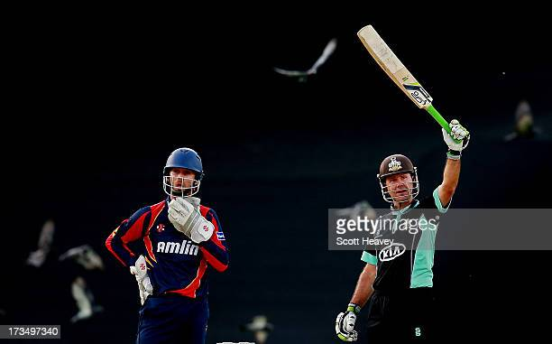 Ricky Ponting of Surrey celebrates his half century during the Friends Life T20 match between Surrey Lions and Essex Eagles at The Kia Oval on July...