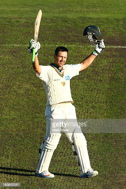 Ricky Ponting of Tasmania celebrates his century during day one of the Sheffield Shield match between the Tasmanian Tigers and the Victorian...