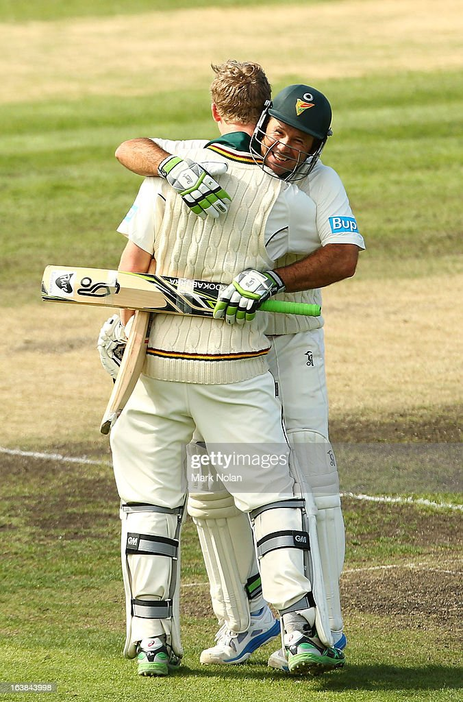 Ricky Ponting of Tasmania embraces team mate Jordan Silk after Silk scored a century during day four of the Sheffield Shield match between the Tasmania Tigers and the Victoria Bushrangers at Blundstone Arena on March 17, 2013 in Hobart, Australia.