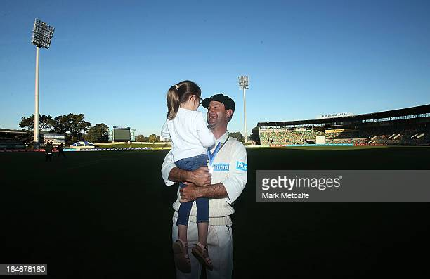 Ricky Ponting of the Tigers holds his daughter Emmy after victory in the Sheffield Shield final between the Tasmania Tigers and the Queensland Bulls...