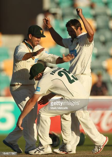 Ricky Ponting of the Tigers is picked up by teammates James Faulkner and Ben Hilfenhaus in celebration of victory in the Sheffield Shield final...