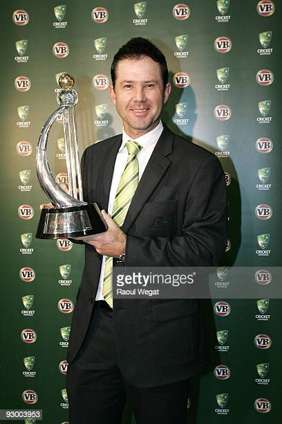 Ricky Ponting poses for a photograph with a trophy during a press conference after arriving back from India after winning the One Day International...