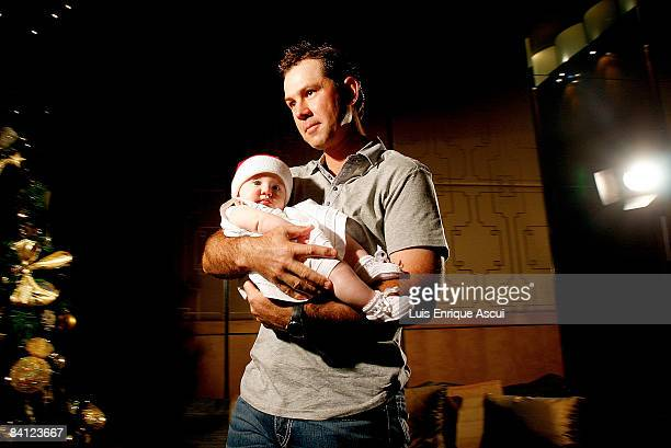 Ricky Ponting poses with his daughter Emmy during the Australian cricket team's Christmas lunch at Crown Towers on December 25 2008 in Melbourne...