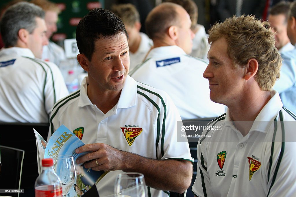 Ricky Ponting speaks with captain of Tasmanian Tigers George Bailey prior to being named Sheffield Shield player of the year during the State Cricket Awards at Blundstone Arena on March 20, 2013 in Hobart, Australia.