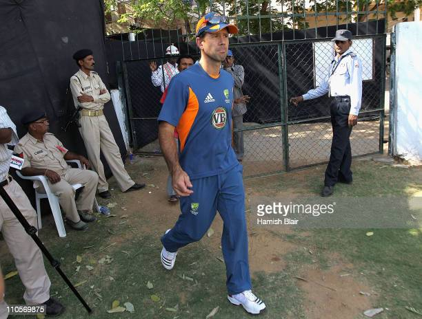 Ricky Ponting walks into the nets past policemen during an Australian nets session at Sardar Patel Stadium on March 22, 2011 in Ahmedabad, India.