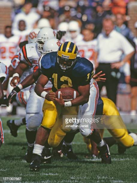 Ricky Powers Running Back for the University of Michigan Wolverines runs the ball during the NCAA Division I-A Big 10 college football game against...