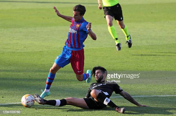 Ricky Puig and Trilles during the friendly match between FC Barcelona and Club Gimnastic de Tarragona, played at the Johan Cruyff Stadium on 21th...