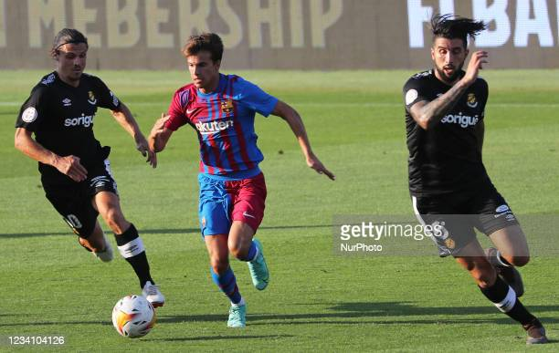Ricky Puig, Fullana and Trilles during the friendly match between FC Barcelona and Club Gimnastic de Tarragona, played at the Johan Cruyff Stadium on...