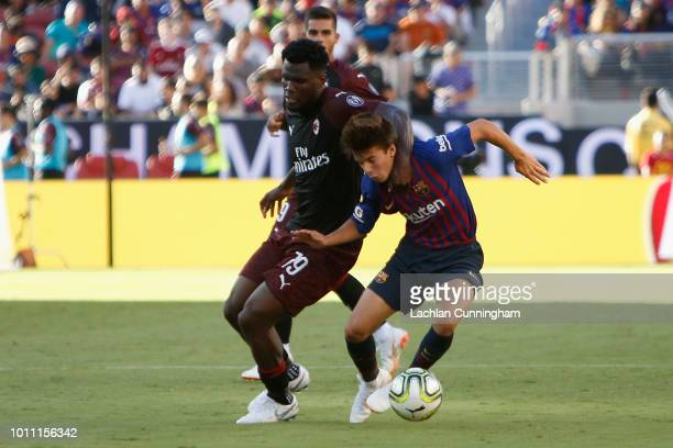 Ricky Puig of FC Barcelona is tackled by Franck Kessié of AC Milan during the International Champions Cup match at Levi's Stadium on August 4 2018 in...