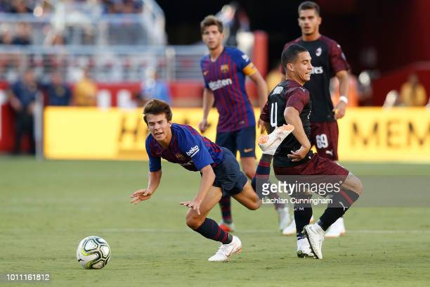 Ricky Puig of FC Barcelona is tackled by José Mauri of AC Milan during the International Champions Cup match at Levi's Stadium on August 4 2018 in...