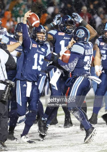 Ricky Ray and Lirim Hajrullahu of the Toronto Argonauts celebrate winning the 105th Grey Cup Championship Game against the Calgary Stampeders at TD...