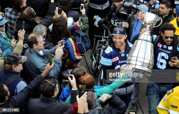 TORONTO ON NOVEMBER 28 Ricky Ray brings the Grey Cup into Nathan Phillips Square through the fans The Toronto Argonauts football club celebrated...