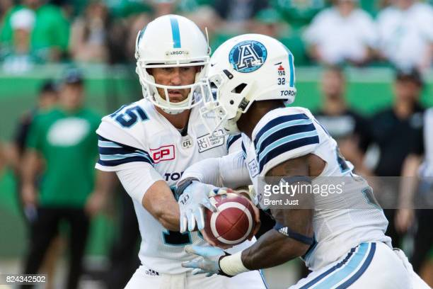 Ricky Ray hands the ball off to James Wilder Jr #32 of the Toronto Argonauts in first half action of the game between the Toronto Argonauts and...