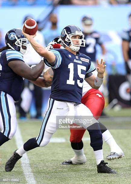 Ricky Ray of the Toronto Argonauts fires a pass against the Calgary Stampeders during a CFL game at the Rogers Centre on July 12 2014 in Toronto...