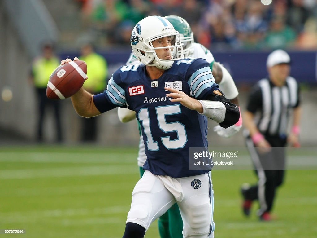 Ricky Ray #15 of the Toronto Argonauts goes to pass while getting pressure from the Saskatchewan Roughriders during a game at BMO field on October 7, 2017 in Toronto, Ontario, Canada. Saskatchewan Roughriders defeated the Toronto Argonauts 27-24.