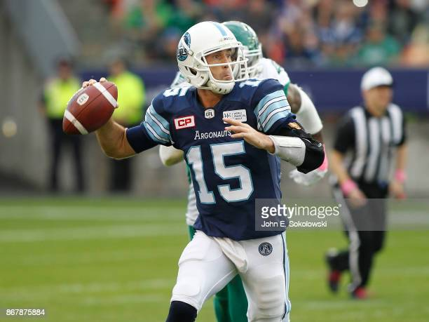 Ricky Ray of the Toronto Argonauts goes to pass while getting pressure from the Saskatchewan Roughriders during a game at BMO field on October 7 2017...