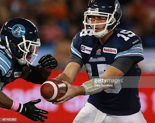 Ricky Ray of the Toronto Argonauts hands the ball off to Curtis Steele of the Toronto Argonauts during their game at Rogers Centre on October 18 2014...