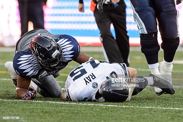 Ricky Ray of the Toronto Argonauts is sacked by John Bowman of the Montreal Alouettes during the CFL game at Percival Molson Stadium on November 2...