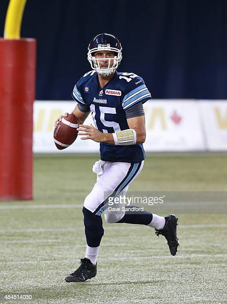 Ricky Ray of the Toronto Argonauts looks to make a pass against the Winnipeg Blue Bombers during their game at Rogers Centre on August 12 2014 in...