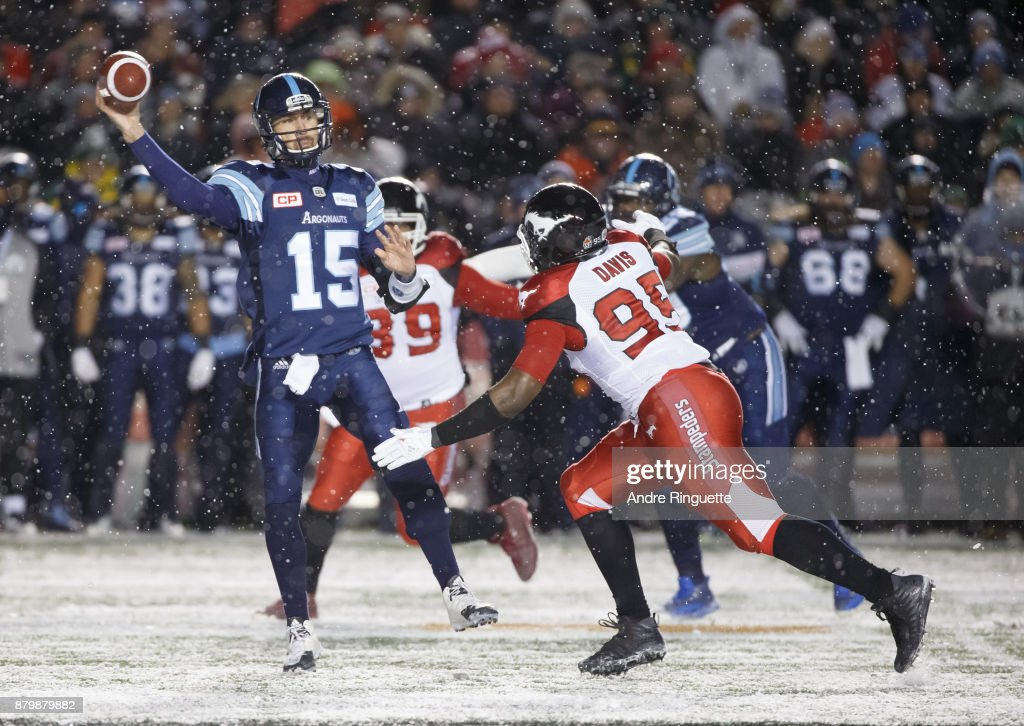 Ricky Ray #15 of the Toronto Argonauts throws the ball as Ja'Gared Davis #95 of the Calgary Stampeders defends against during the second half of the 105th Grey Cup Championship Game at TD Place Stadium on November 26, 2017 in Ottawa, Canada.