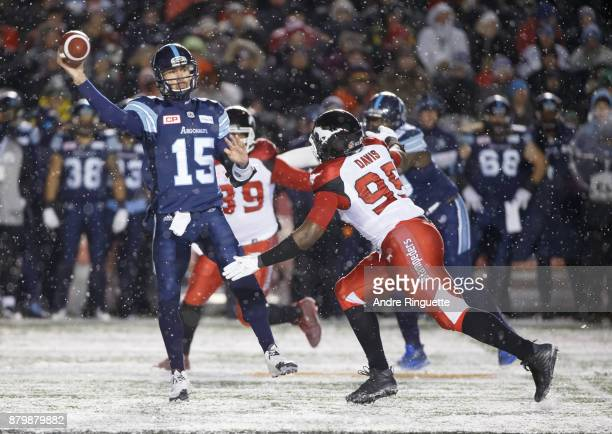 Ricky Ray of the Toronto Argonauts throws the ball as Ja'Gared Davis of the Calgary Stampeders defends against during the second half of the 105th...