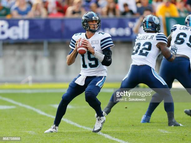 Ricky Ray of the Toronto sets up to pass behind the blocking of James Wilder Jr #32 of the Toronto Argonauts against the Edmonton Eskimos during a...