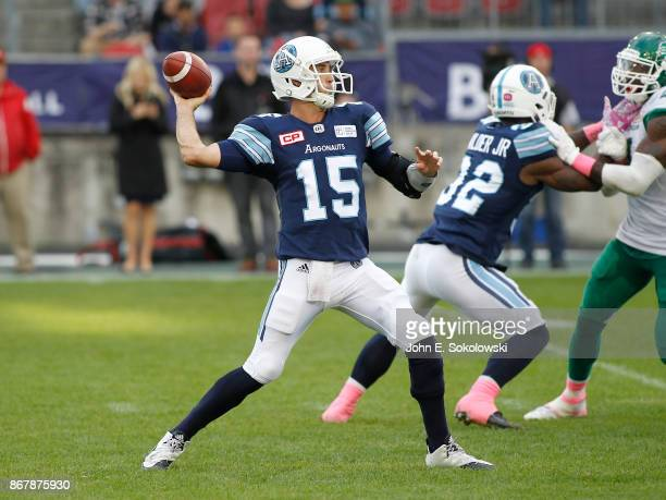 Ricky Ray throws a pass as James Wilder Jr #32 of the Toronto Argonauts blocks against the Saskatchewan Roughriders during a game at BMO field on...