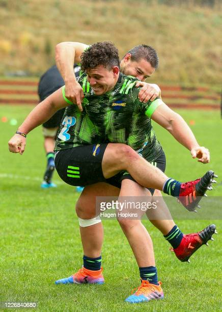 Ricky Riccitelli and Dane Coles take part in a drill during a Hurricanes Super Rugby training session at Rugby League Park on May 25, 2020 in...