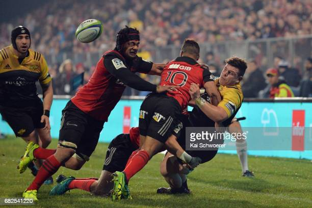 Ricky Riccitelli of the Hurricanes offloads the ball during the round 12 Super Rugby match between the Crusaders and the Hurricanes at AMI Stadium on...