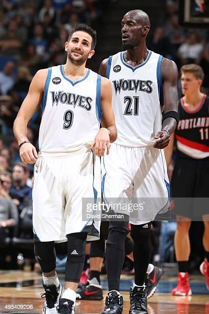 Ricky Rubio and Kevin Garnett of the Minnesota Timberwolves during the game against the Portland Trail Blazers on November 2 2015 at Target Center in...