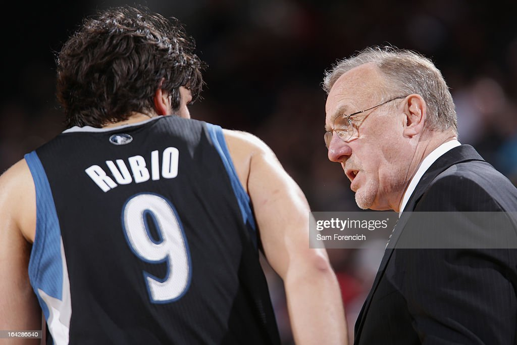 Ricky Rubio #9 and Rick Adelman of the Minnesota Timberwolves talk during the game against the Portland Trail Blazers on March 2, 2013 at the Rose Garden Arena in Portland, Oregon.