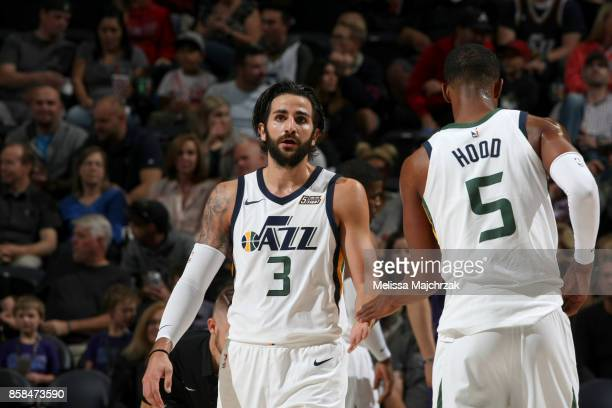 Ricky Rubio and Rodney Hood of the Utah Jazz high five during the game against the Phoenix Suns on October 6 2017 at vivintSmartHome Arena in Salt...